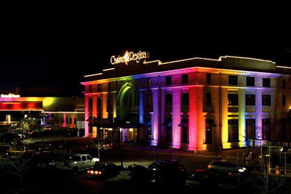 Casino Regina building lit up at night with multi-colored LEDs