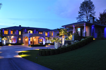 front exterior at night of Mercer Island Residence using Pulsar ChromaBump MR16 LED architectural lighting