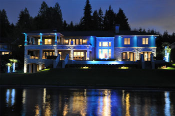 back exterior at night of Mercer Island Residence using Pulsar ChromaBump MR16 LED architectural lighting