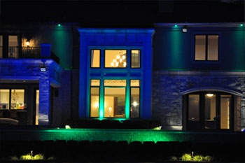 close up back exterior at night of Mercer Island Pulsar ChromaBump MR16 Residence using LED architectural lighting