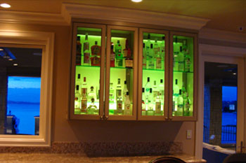 interior of Mercer Island Residence kitchen bar cabinet using green Pulsar ChromaStrip1200 LED accent lighting