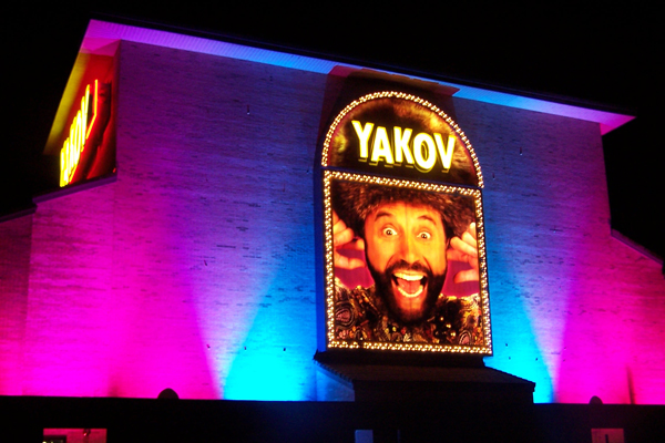 Yakov Smirnoff Show building lit at night using City Color 2500s and Dominator architectural lights by Studio DueStudio Due