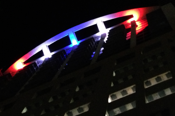 Solaire at the Plaza Condos of Orlando lit at night with red white and blue Quadro 24 LEDs