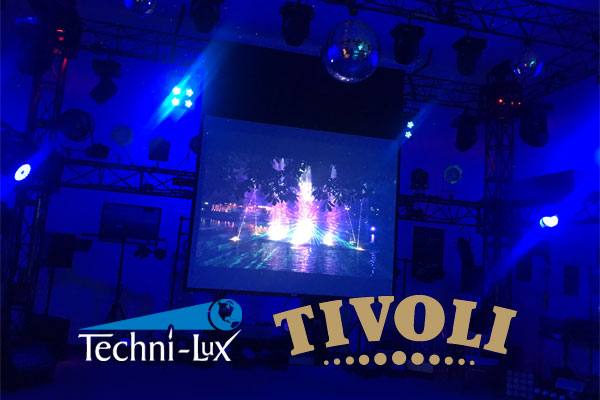 Techni-Lux showroom lit with blue LED lights with screen projecting TIVOLI Gardens