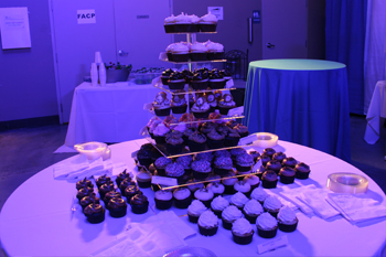 dessert table with various flavored cupcakes displayed on 5 tiered stand Techni-Lux Technology Day