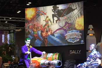 Sally Corporation booth at 2014 IAAPA conference promoting the Interactive dark ride Justice League: Battle For Metropolis 4D for Six Flags Theme Parks, U.S.A.