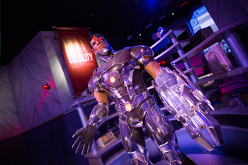 Interactive dark ride Justice League: Battle For Metropolis 4D building interior animatronic DC comic character Cyborg queue line at Six Flags Theme Parks, U.S.A.