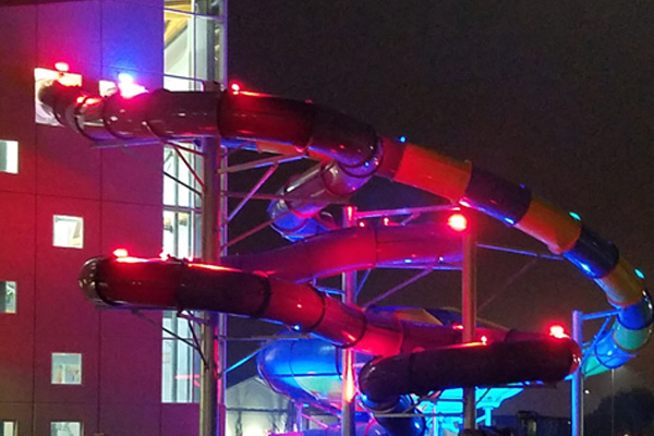 Exterior LED lights at night on water slide, 