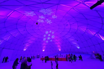 interior Artic Igloo, a snow play area walls are splashed with pink and purple color LED bars and snowflakes gobos at Snowcat Ridge Alpine Snow Park - Dade City, Florida