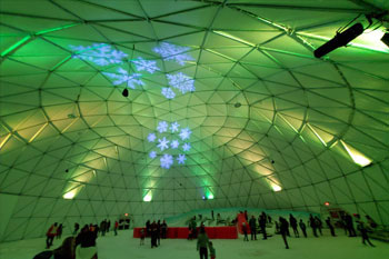 interior Artic Igloo, a snow play area walls are splashed with green and white color LED bars and snowflakes gobos at Snowcat Ridge Alpine Snow Park - Dade City, Florida